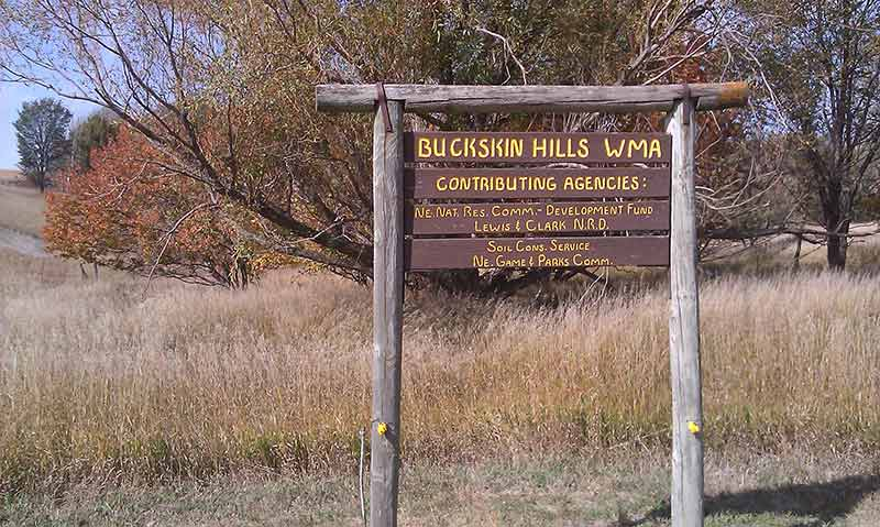 Brown wooden sign for Buckskin Hills WMA.